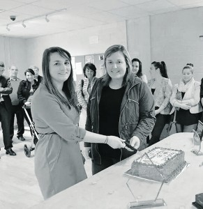 Laura Scanlan (Vice Chairperson) and Elaine O'Leary (Secretary) cutting the cake.  Black Diamond Photography Newcastle West Youth Club Opening