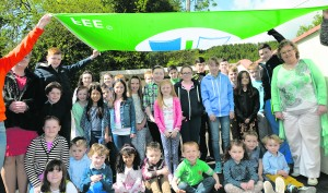 The Green Schools committee with their coordinator Marion Brosnan. G Mol Scoil Naomh Íde Ashford Raise Green Flag