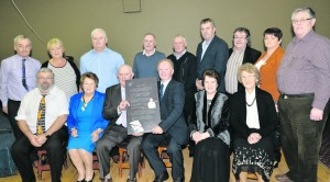 Tom McKenna making a presentation to Donie and Betty Lyons on behalf of West Limerick Singing Club. G Mol West Limerick Singing Club Honour Donie Lyons