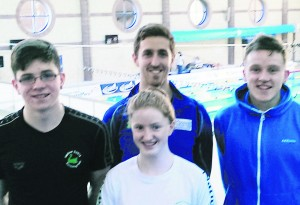 Taking a break from swimming at  at the Irish Short Course Championships in Lagan Valley Leisureplex, Lisburn, were   Cadan McCarthy, Cormac Powell (coach), Ella Fuohy and Mark Walsh, Mallow Swans Swimming Club.