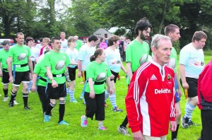 Benny Henry leading out the Mallow Barbarians RFc team for a game against Garrowen last June at Mallow RFC grounds. Pic S Murphy.