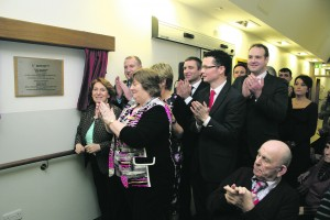 Minister Kathleen Lynch unveiling the plaque declaring the official opening of the Rehab Unit. DO NOT CROP THIS PHOTOGRAPH. PUT PHOTO OF PLAQUE ALONGSIDE THIS!!!!!