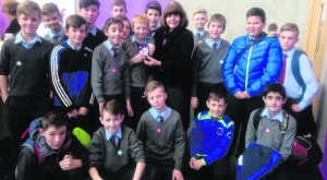 Jamie Fahy accepts the award on behalf of the 6th class, Courtenay N.S., from Judge Marie Walsh at the RDS Primary Science Fair in Mary Immaculate College, Limerick. Courtenay NS Newcastle West