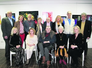 The North Kerry Arts Group who exhibited at the Red Door Gallery, Newcastle West on Thursday last. Back row: Malcolm Donald, Lisa Fingleton, James Dunn, Susan Hitching, David Morrison, Viveca Amoto, Adrian Everson with Billy Keane who opened the exhibition. Front row: Mary Finucane, Rebecca Carroll, Liam Brennan, Marie Brennan and Noreen Breen. George Daly North Kerry Arts Group Colourful Spirits Exhibition at Red Door