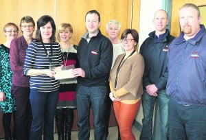 A Coffee Morning was held last week in the Mallow Primary Healthcare Centre, organised by HSE staff, at which Eileen Doolan presented a cheque for 1,000 euro to John Paul Merritt of Mallow Search and Rescue. Pic S Murphy.