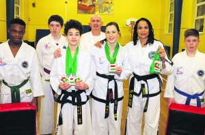 Members of Mallow Taekwondo and Kickboxing Club pictured with instructor Mrs. Dalton and the medals which they won at the European Championships in Budapest.