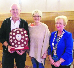 Speakeasy Toastmaster of the Year Sean Corcoran pictured holding the Jerry mulcahy Memorial trophy, with Jerry's daughter Mary O'Sullivan, and Toastmasters President Marie Lynes.