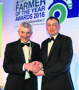 Robert O'Dea is presented with the prestigious 'Dairy Farmer of the Year' award by John Comer of ICMSA at the recent Zurich Insurance - Farming Independent Presentation Dinner in Dublin