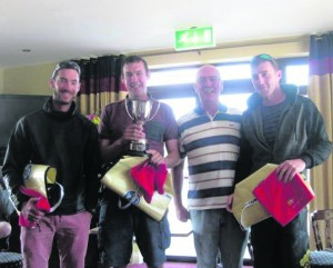 Proud prize winners of the Munster Mermaid Championships at Foynes Yacht Club.  Mark McCormack, Darragh McCormack (skipper) and Cathal McMahon pictured with Commodore James McCormack. FOYNES HOST MERMAID MUNSTER CHAMPIONSHIP