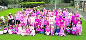 Grandparents, parents and pupils all dressed in pink pictured last Thursday prior to the 5k walk. -  Wacky Pink Day   --  Photo by Paul Ward -