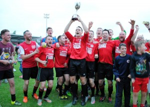 The Buttevant players and supporters celebrate after winning the County Cup following a 3-1 penalty shoot-out victory over CFC Banteer at the Cross on Monday night. Barry Peelo.