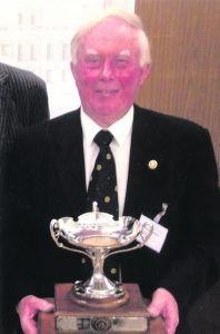 Gerry Callanan of the Rotary loub of Mallow proudly holds the cup after the Ireland and Scotland team which he captained won the Rotary Club of St Andrew's International Golf Tournament.