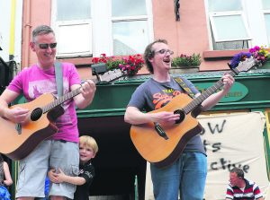 Conor Murphy helped his daddy Danny, and uncle Eoghan, during their performance at the Sing for Your Hometown event in Mallow last Saturday. 17 local acts played on the Civic Plaza, Market Square and Bank Place for the afternoon, part of the Cork Co. Council-organised Living Space Project.