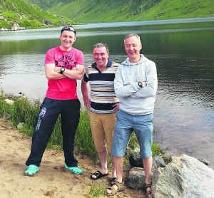 Adrian Healy, Kevin Myers and Denis Merritt of Mallow Masters Swimming Club who took part in a 4K swim at Glenbeg Lough last Sunday. Adrian finished runner-up in his category.