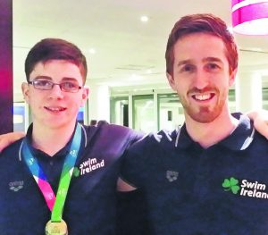 Cadan McCarthy, who wil swim for Ireland at the Schools' Games in the UK this weekend, pictured with coach Cormac Powell.