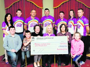 Members of Remembering Zoë committee presenting a cheque €1,000 to Abbeyfeale Community Games. Front: Gearóid Collins, Tiernan Collins, Lee Collins, Alisha Scannell, Noreen Cullinane, Aoife Cullinane. Back: Trish Roche, Michael Lane, John Collins, Shane O'Connor, Tom O'Shaughnessy, Anna O'Sullivan, Eddie Murphy. Paul Ward Remembering Zoe Cheque Presentations