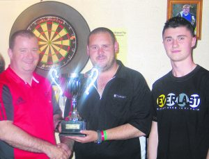 Mick Davitt and son Colin presenting the Breda Davitt Memorial Cup to Nicky Sherman.