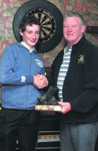 Winner Chris Fehilly of Macroom Trout Anglers receiving the Mark Healy Trophy from Kevin Healy at the All Ireland River Competition in Mallow last weekend.