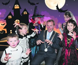 County Mayor Seamus McGrath gets a fright from some scary little friends as he lends his support to the Ghostbusters 5K run/walk in aid of Anchor Treatment Centre which will be held at Doneraile Park at 11.30am this Saturday Oct 29th.