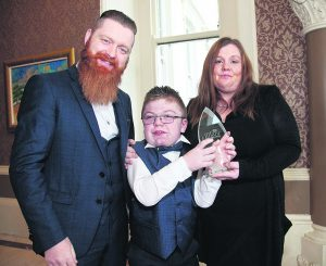 Billy Kiely, BT Child Hero, pictured with his parents Will and Christine after receiving his award.