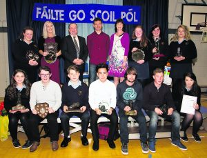 Some of the recipients with their trophies at the Scoil Pól, Kilfinane, awards night last week. Also in pic: Mr. Mike O'Hara, principal, Mr. Eoghan Clifford, Guest of Honour and Ms. Bridget Ryan, vice principal