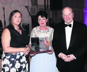 Rose Hynes, chair of Shannon Group presenting the Mid-West Media Merit award to Caroline McNamara, wife of the late jockey JT McNamara, with Minister for Finance Michael Noonan