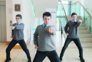 Paul Heavin, Alan Culligan and Niall O'Se, Patrician Academy students who won medals at the Patterns Taekwondo Finals, in UL recently.