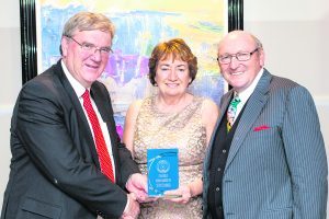 Pat McDonagh, owner of Supermac's and Hotelier, present the 'Services Award to Mary and Jerry Morrissey, owner of the Vale/Mallow Star/Weekly Observer Newspaper at the Charleville Business Awards, presented by Charleville Chamber held t the Charleville Park Hotel. Photo by Wm. Casey
